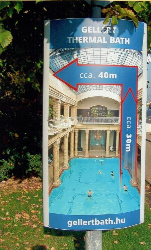 An advertisement by the St. Gellért Baths features the famous pool.