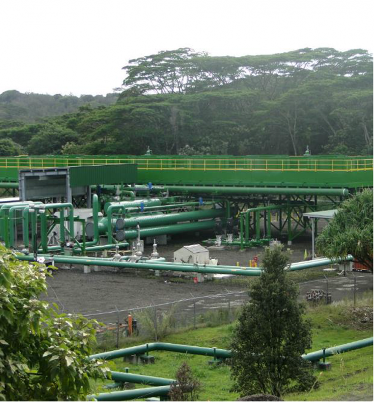 Outside view of geothermal power plant with green pipes in California